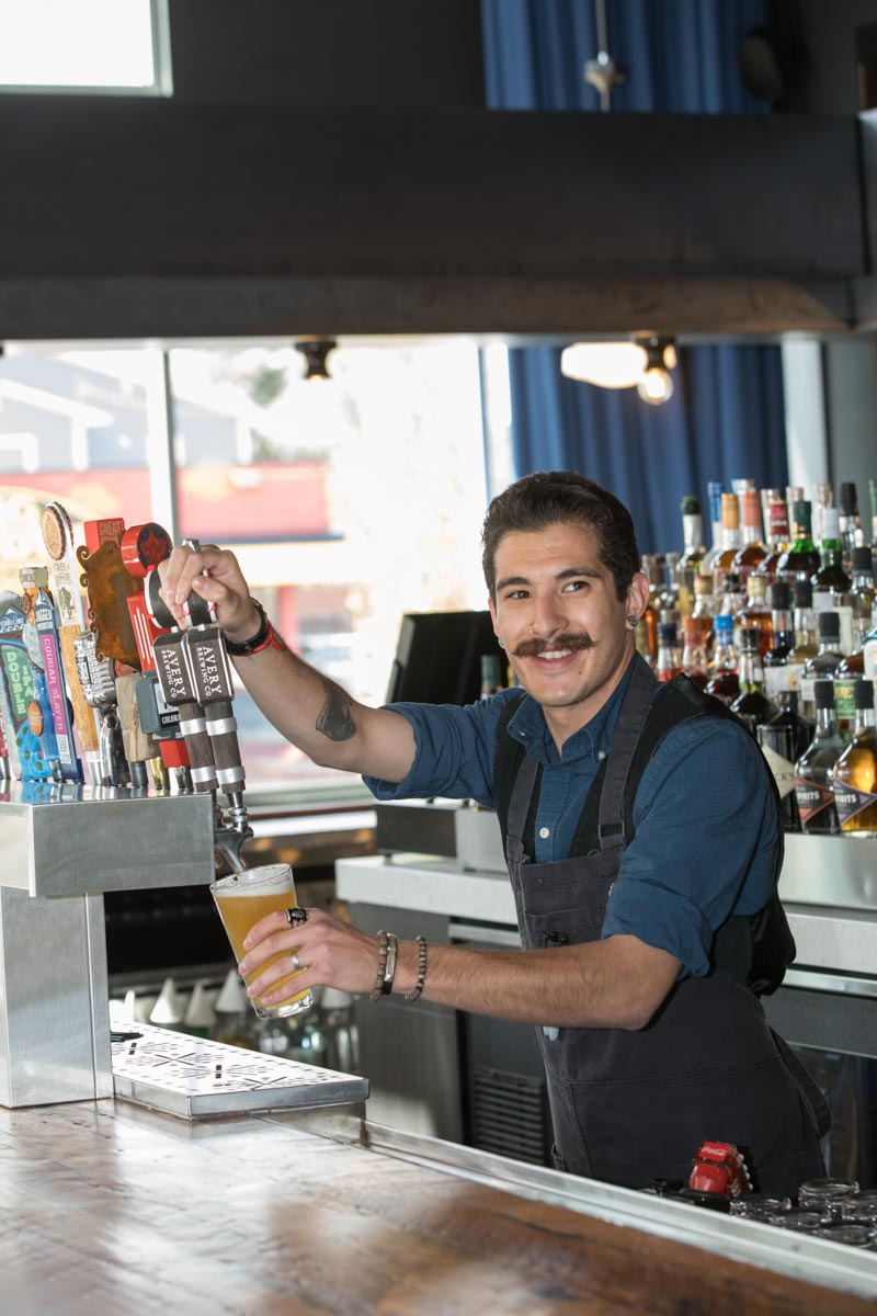Bartender at Alamo Drafthouse pouring local beer