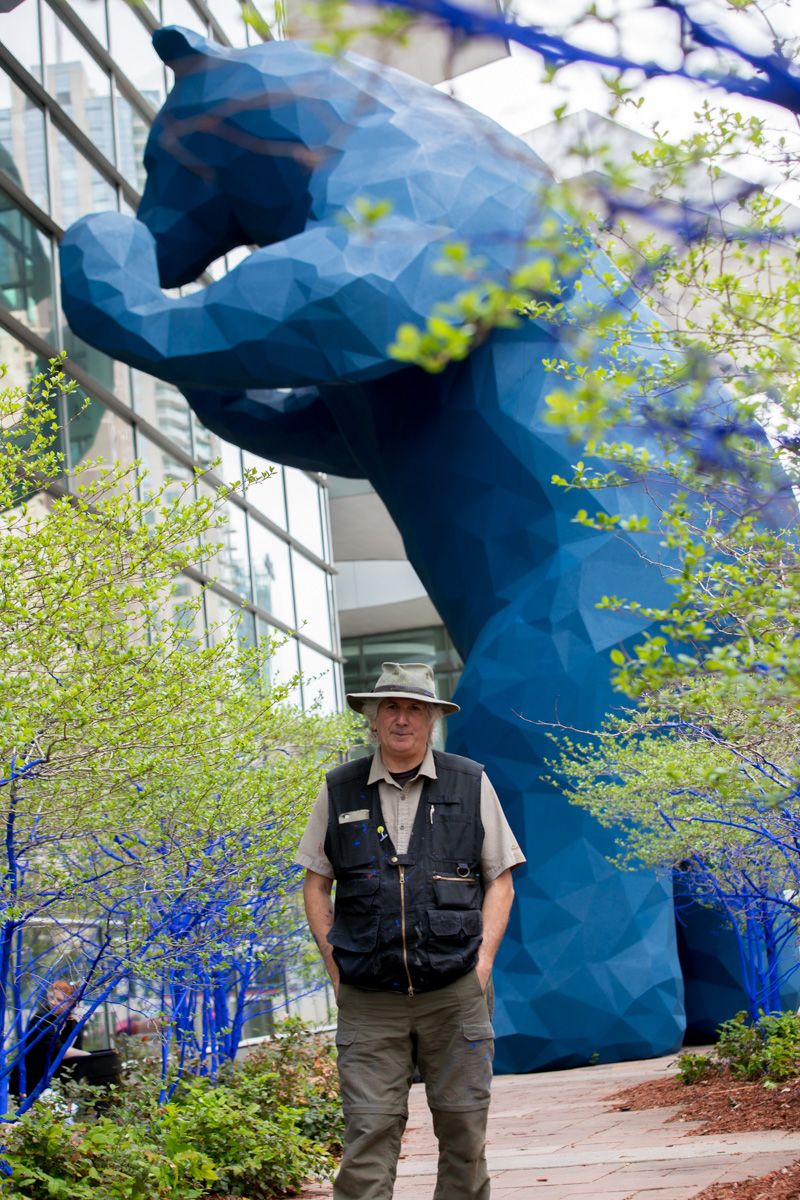 Why are the trees in Denver Blue? | Denver Photographer, big blue bear, Colorado convention center, Kon art project, blue trees, man in fishing hat, man with grey hair, portrait of Kon, artist portrait