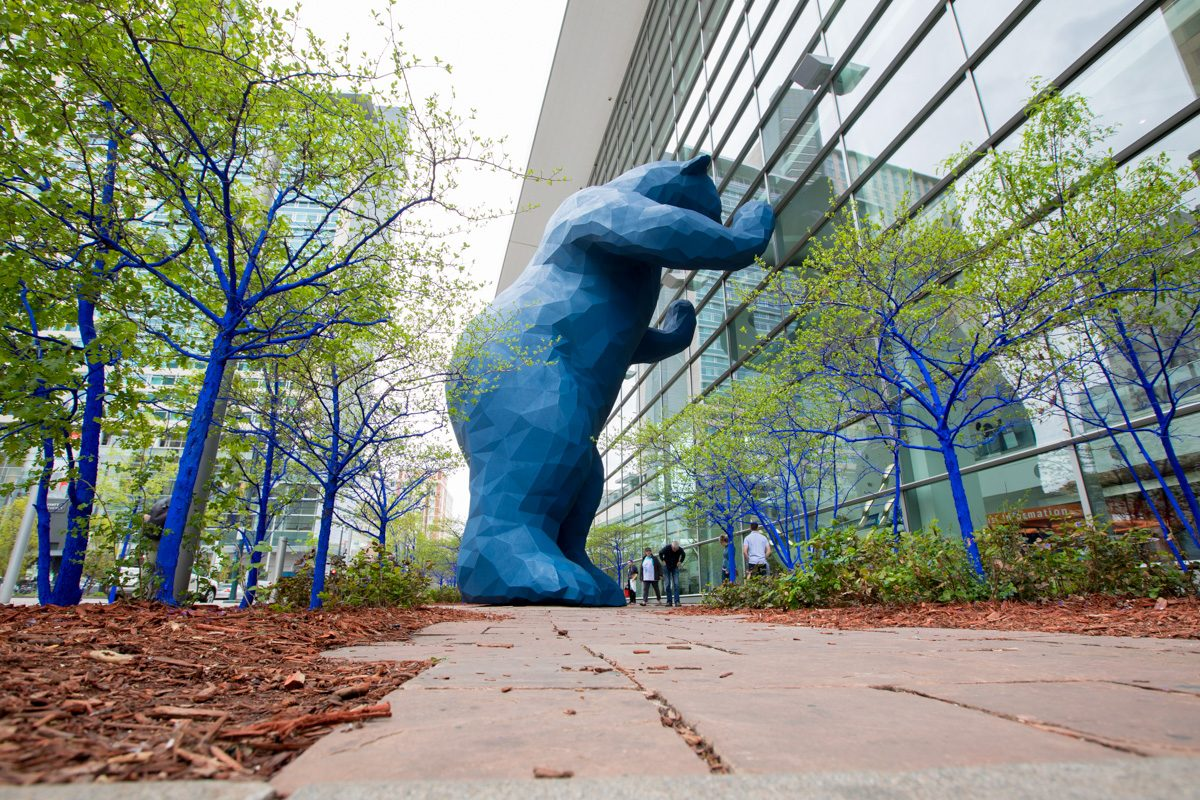Why are the trees in Denver Blue? | Denver Photographer, big blue bear, Colorado convention center, Kon art project, blue trees, man in fishing hat, man with grey hair, portrait of Kon, artist portrait, couple in from to CCCblue bear, CCC photographer
